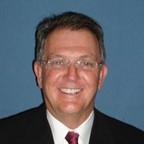 Dr. Brad D Justesen