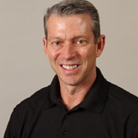 Dr. Bruce E Houser