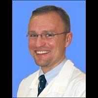 Dr. Cezar M Mitrut