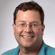 Dr. Chris E Doucet