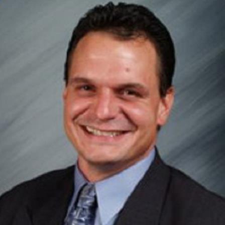Dr. Christopher E. Kazor