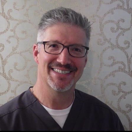 Dr. Clark D Cash