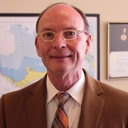 Dr. E L Miller