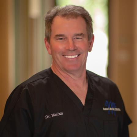 Dr. James J McCall
