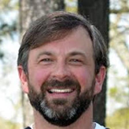 Dr. James D White
