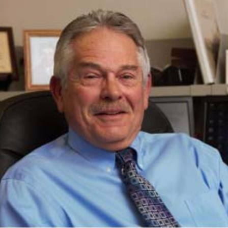Dr. John L Bouzis