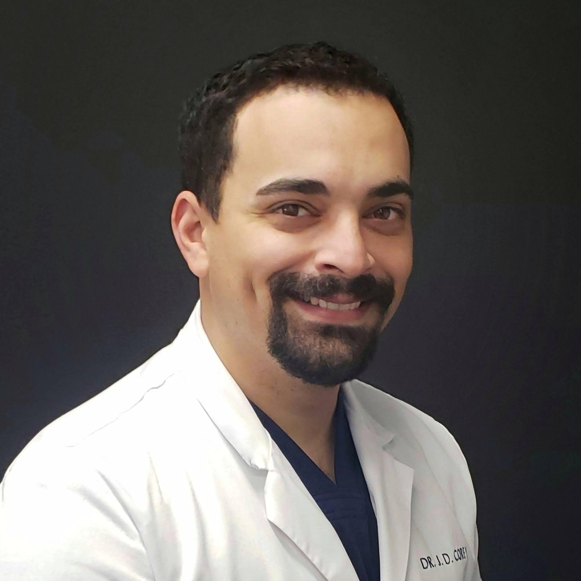 Dr. John D. Corey