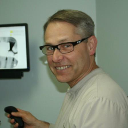Dr. John J Kozicki