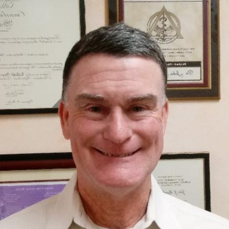 Dr. John J Moynihan