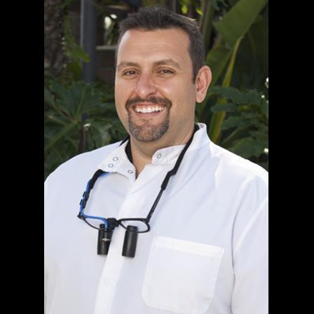 Dr. John G Scalas