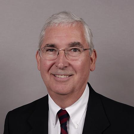Dr. J Alexander Smith