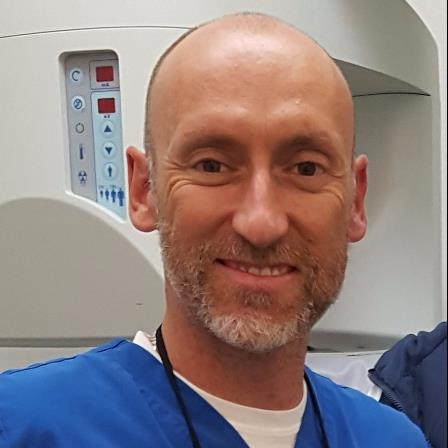 Dr. John K Swain