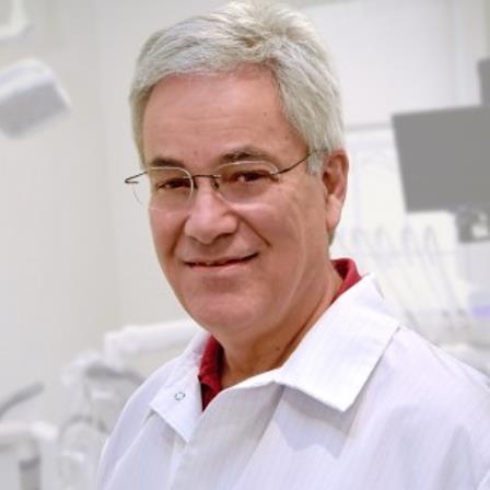 Dr. John E Tozer