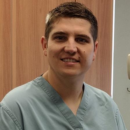Dr. Justin C White