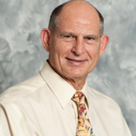 Dr. M Glenn Barker