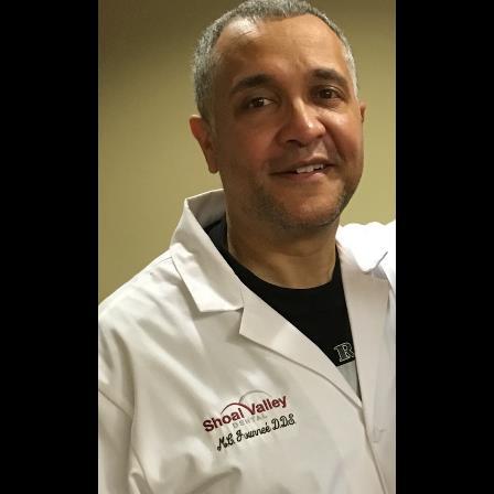 Dr. M Conrad Journee