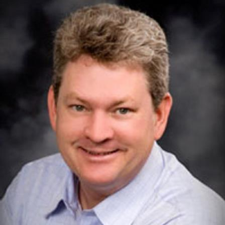 Dr. Thomas E. Herremans