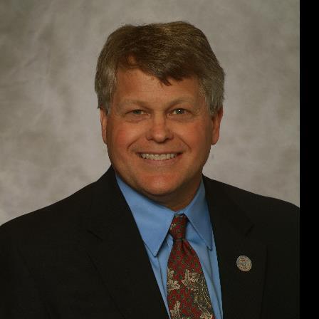 Dr. Tim R Holland
