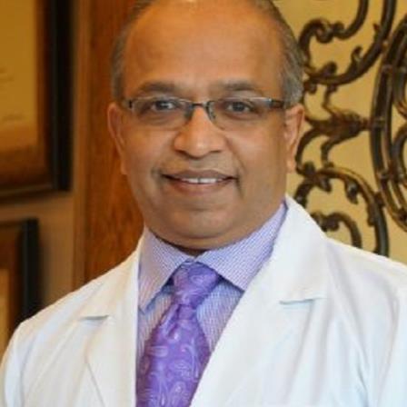 Dr. Tushar P Doshi